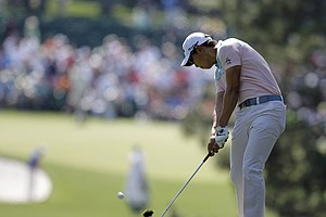 Sang-Moon Bae, of South Korea, hits off the first fairway during the third round of the Masters.