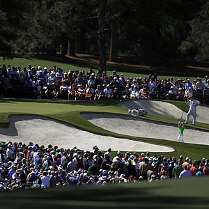 Luke Donald, of England, hits out of a bunker on the second hole during the third round of the Masters.