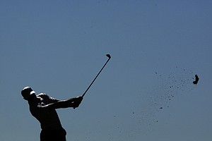 Tiger Woods tees off on the fourth hole during the third round of the Masters.