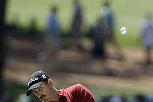Geoff Ogilvy, of Australia, hits off the third fairway during the third round of the Masters.