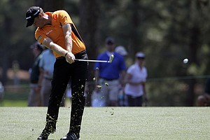 Peter Hanson, of Sweden, hits off the first fairway during the third round of the Masters.