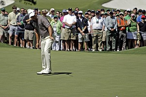 Graeme McDowell, of Northern Ireland, watches his birdie putt on the third hole during the third round of the Masters.