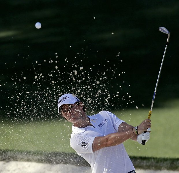 Rory McIlroy, of Northern Ireland, hits out of a bunker on the 10th hole during the third round of the Masters.