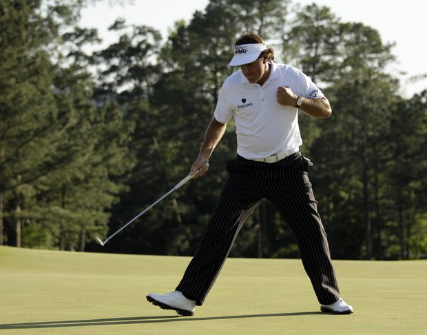 Phil Mickelson pumps his fist after a birdie putt on the 18th green during the third round of the Masters.