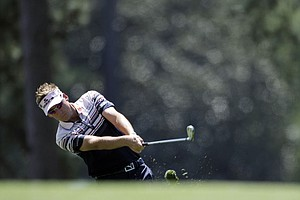 Ian Poulter, of England, hits off the first fairway during the third round of the Masters.