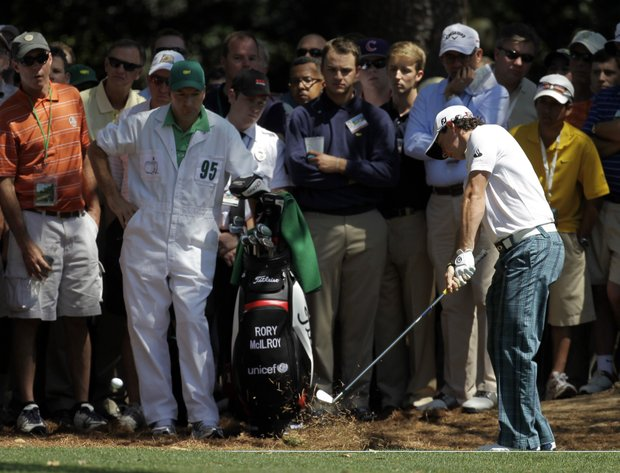 Rory McIlroy, of Northern Ireland, hits out of the rough off the first fairway during the third round of the Masters.
