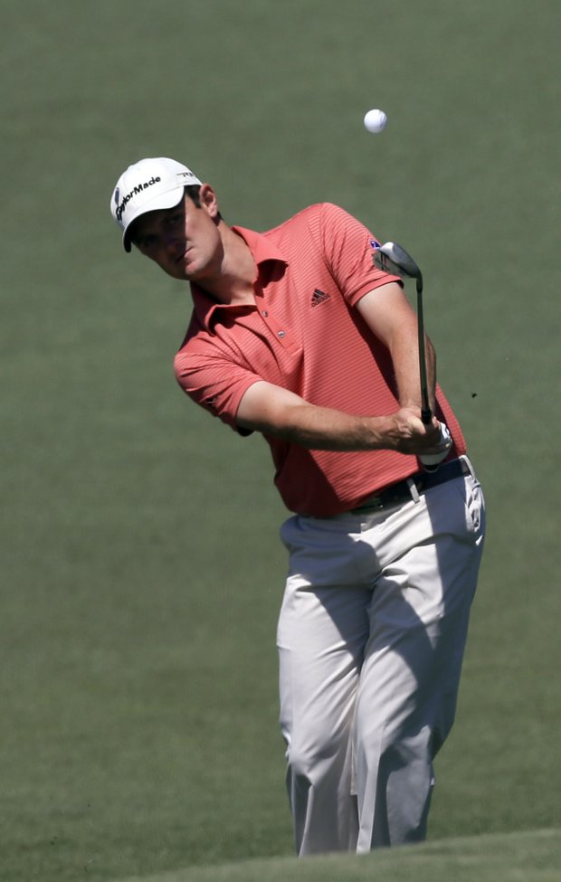Justin Rose, of England, hits to the second fairway during the third round of the Masters.