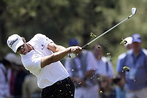Adam Scott, of Australia, takes his second shot on the first fairway during the third round of the Masters.