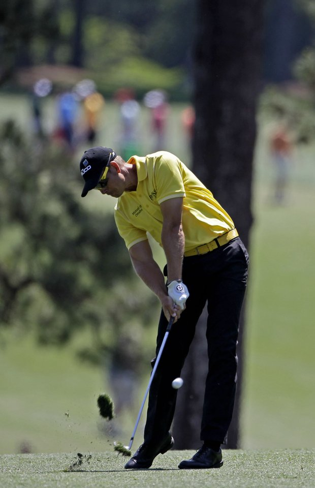 Henrik Stenson, of Sweden, hits off the first fairway during the third round of the Masters.