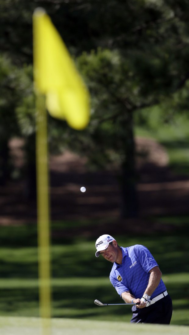 Lee Westwood, of England, chips to the seventh green during the third round of the Masters.