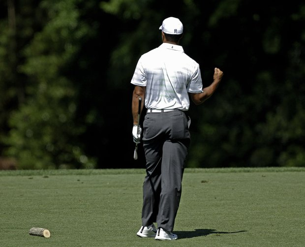 Tiger Woods pumps his fist after hitting a tee shot on the fourth hole during the third round of the Masters.