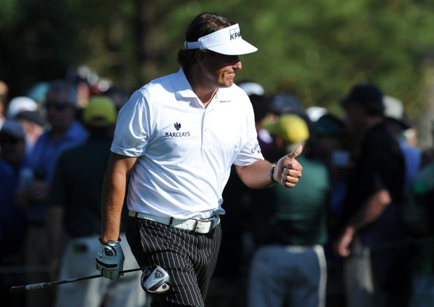 Phil Mickelson gives the thumbs up to a girl to who he gave a ball on the 15th hole during the third round of the 76th Masters. Mickelson would make an improbable birdie at the par 5 after a beautiful lob-wedge shot from just off the back of the green.