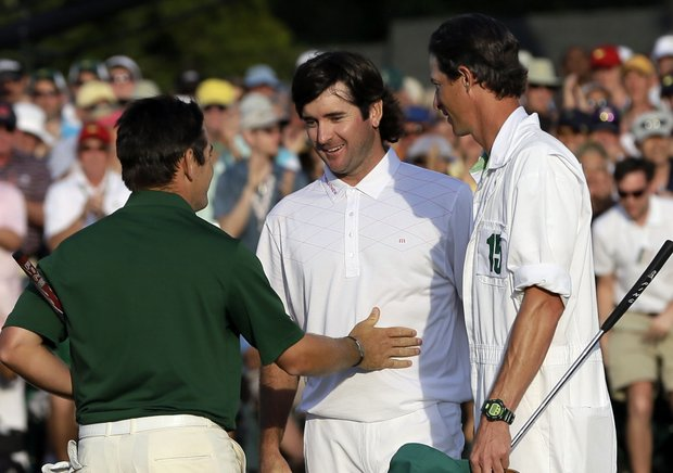 Louis Oosthuizen, left, of South Africa, congratulates Bubba Watson on the 18th green following their fourth round of the Masters.