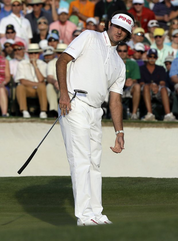 Bubba Watson watches his putt on the 18th green during the fourth round of the Masters.