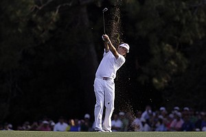 Bubba Watson hits off the 18th fairway during the fourth round of the Masters.