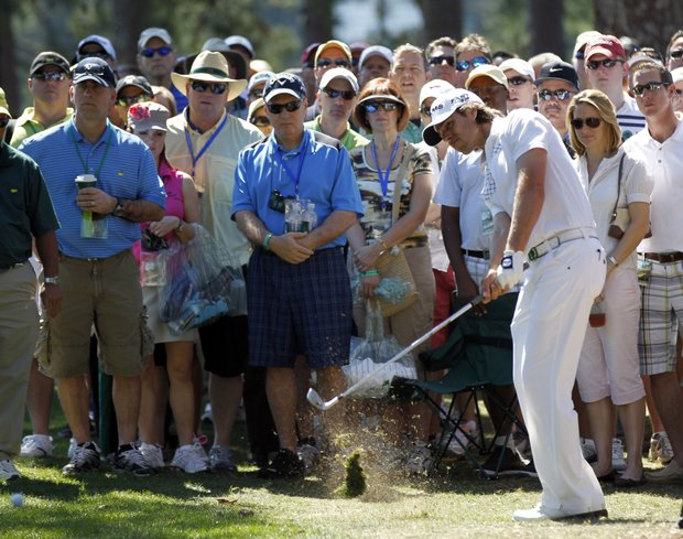 Aaron Baddeley, of Australia, hits out of the rough off the first fairway during the fourth round of the Masters.