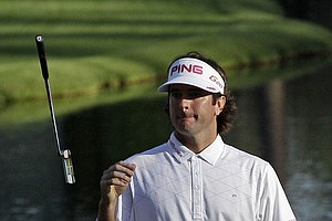 Bubba Watson tosses his putter after missing a putt on 16th green the during the third round of the Masters.
