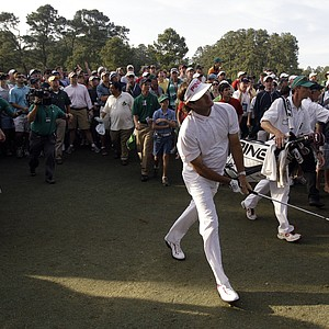 Bubba Watson watches his shot from the rough off the 17th hole during the fourth round of the Masters.