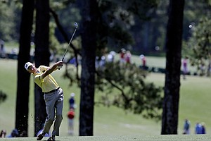 Jim Furyk hits off the first fairway during the fourth round of the Masters.