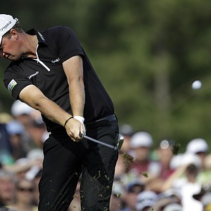 Peter Hanson, of Sweden, hits off the 12th tee during the fourth round of the Masters.