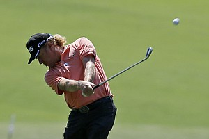 Miguel Angel Jimenez, of Spain, hits off the first fairway during the fourth round of the Masters.