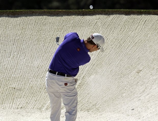 Zach Johnson hits out of a bunker on the second fairway during the fourth round of the Masters.