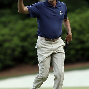 Matt Kuchar holds up his ball after a birdie putt on the 13th hole during the fourth round of the Masters.