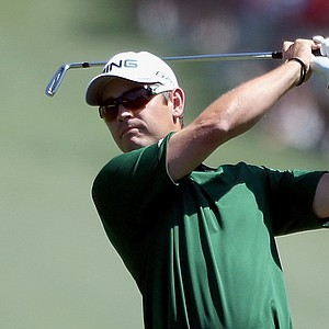 Louis Oosthuizen of South Africa hits a shot on the first hole during the final round of the 2012 Masters.