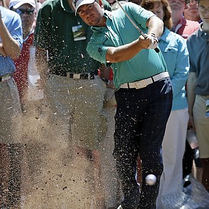 Graeme McDowell, of Northern Ireland, hits out of the rough off the first fairway during the fourth round of the Masters.