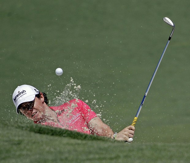 Rory McIlroy, of Northern Ireland, hits out of a bunker on the second hole during the fourth round of the Masters.