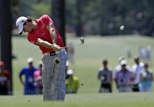 Rory McIlroy, of Northern Ireland, hits off the first fairway during the fourth round of the Masters.