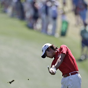 Kevin Na hits off the first fairway during the fourth round of the Masters.