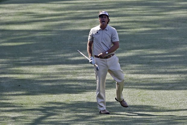 Phil Mickelson yells at his ball after hitting his second shot on the seventh fairway during the fourth round of the Masters.