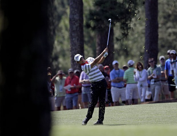 Adam Scott, of Australia, hits off the first fairway during the fourth round of the Masters.