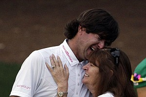 Bubba Watson hugs his mother Mollie after winning the Masters golf tournament following a sudden death playoff on the 10th hole.
