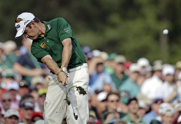 Louis Oosthuizen, of England, tees off on the 12th hole during the fourth round of the Masters.
