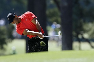 Tiger Woods hits off the first fairway during the fourth round of the Masters.