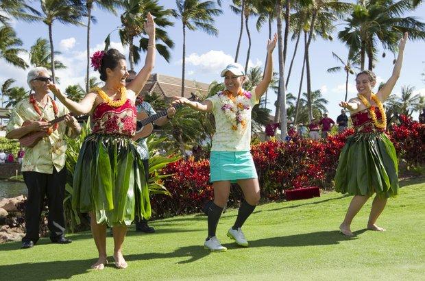 Ai Miyazato, center, dances the hula after winning the LPGA LOTTE Championship golf tournament at Ko Olina Golf Club.