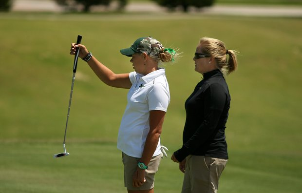 Kelli Pry of University of South Florida with head coach Marci Kornegay at No. 9 during the Big East Women's Championship at Reunion Resort.