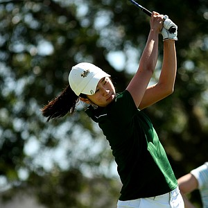 Shena Yang of the University of South Florida tees off at No. 8 during the final round of the Big East Women's Championship at Reunion Resort.