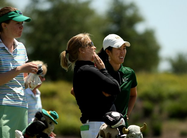 University of South Florida head coach Marci Kornegay shares a laugh with Shena Yang at no. 12 during the final round of the Big East Women's Championship at Reunion Resort.