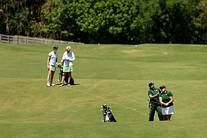 University of South Florida's Amy West and assistant coach Janice Olivencia, far right, watch West's shot at No. 18 during the final round of the Big East Women's Championship at Reunion Resort. Far left is Notre Dame head coach Susan Holt and player Ashley Armstrong, the individual champion.