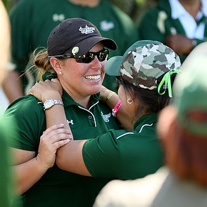 University of South Florida's Amy West and assistant coach Janice Olivencia celebrate their win at the Big East Women's Championship at Reunion Resort.