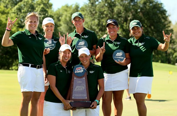 University of South Florida pose with the trophy after winning the Big East Women's Championship at Reunion Resort.