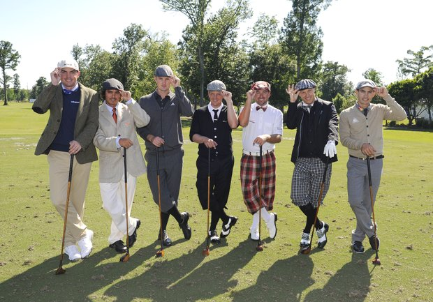 Keegan Bradley, Rickie Fowler, Justin Rose, Luke Donald, Graeme McDowell, Ben Crane, and Camilo Villegas all dressed in 1912 era clothes with clubs pose for the Fore!Kids Foundation 3-hole charity shoot out for the Zurich Classic of New Orleans at TPC Louisiana.