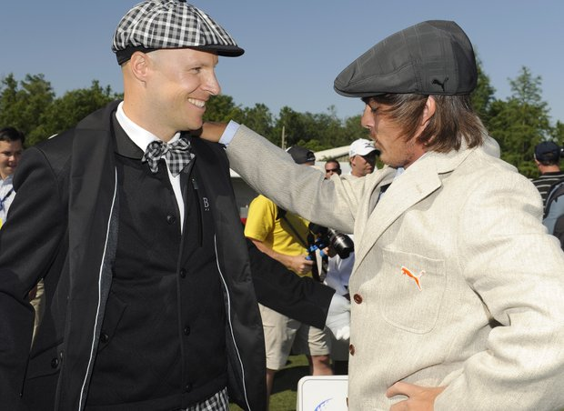 Ben Crane, left, and Rickie Fowler dressed in 1912 period clothes are seen on the practice range before the start of the Fore!Kids Foundation 3-hole charity shoot out during the Zurich Classic of New Orleans at TPC Louisiana.
