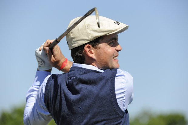 Keegan Bradley dressed in 1912 period clothes hits balls with a vintage club on the practice range before the start of the Fore!Kids Foundation 3-hole charity shoot out during the Zurich Classic of New Orleans at TPC Louisiana.