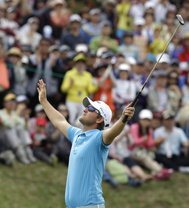 Bernd Wiesberger of Austria celebrates his victory after finishing the final round of the Ballantine's Championship.