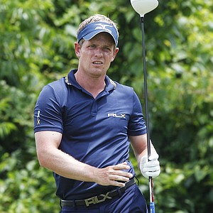 Luke Donald watches his tee shot on the second tee in the Zurich Classic at the TPC Louisiana course in Avondale, La.