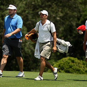 Notre Dame head coach Jim Kubinski walks with his player Max Scodro during the Big East Men's Championship at Reunion Resort.